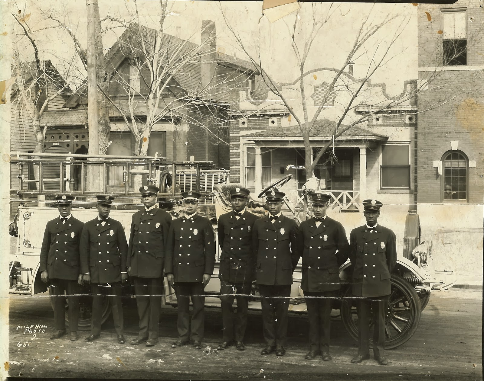 African American firefighters post outside of station #3 circa 1940