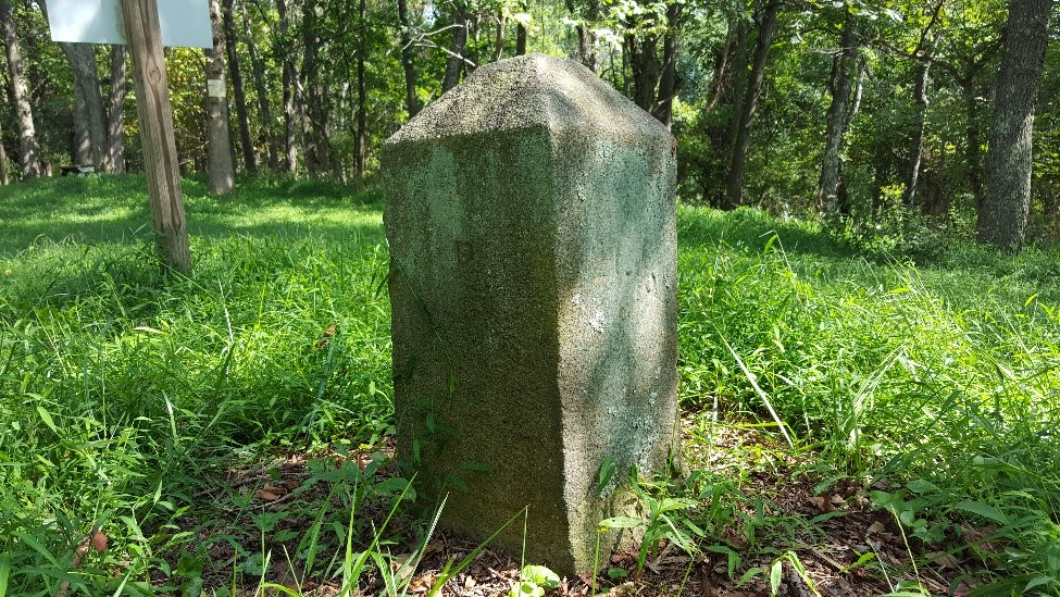 This stone marker was placed in 1883, as the original wood and earth marker had deteriorated significantly.