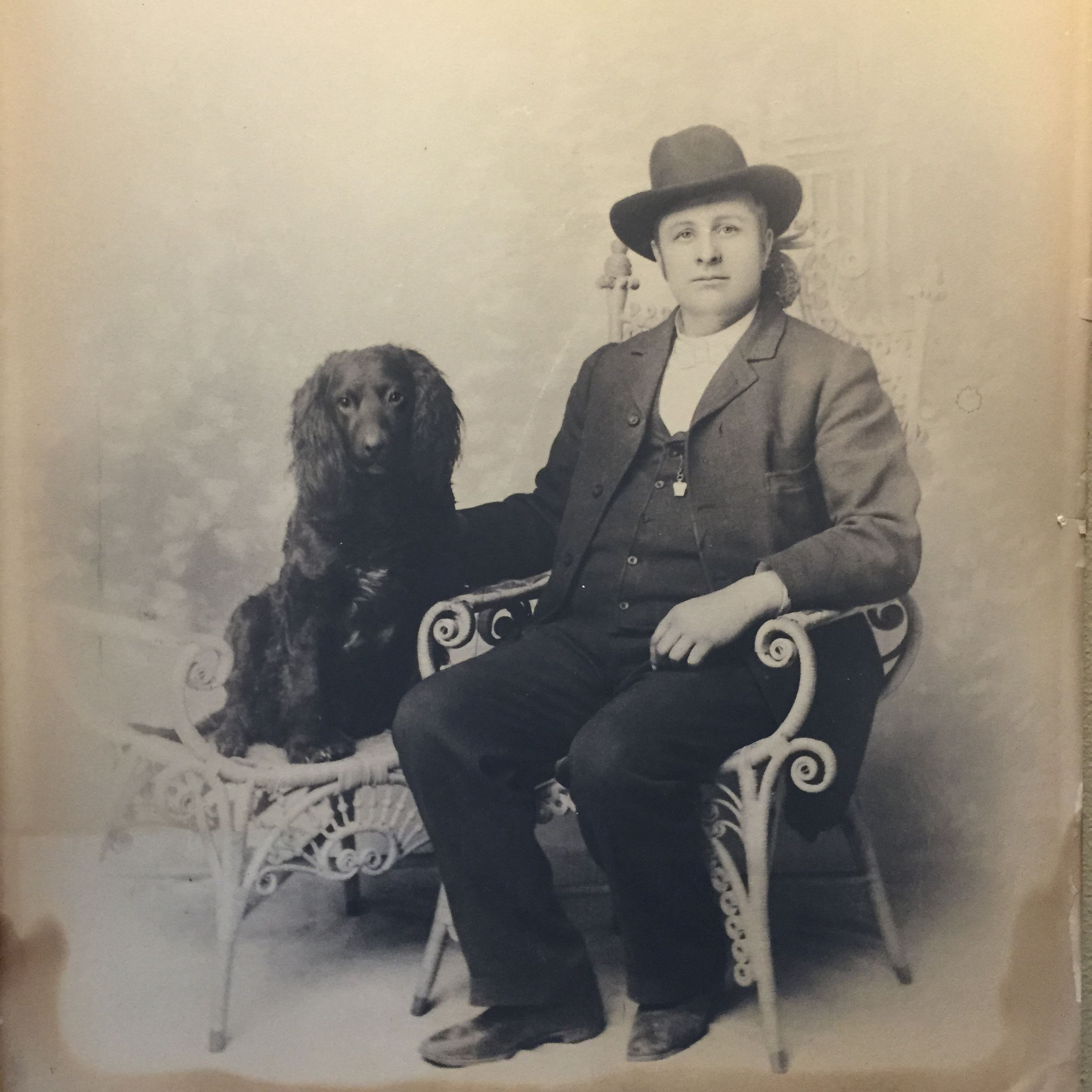 Bisbee's first librarian, Reverend J.G. Pritchard and his Cocker Spaniel. Photo courtesty of the Bisbee Mining and Historical Museum