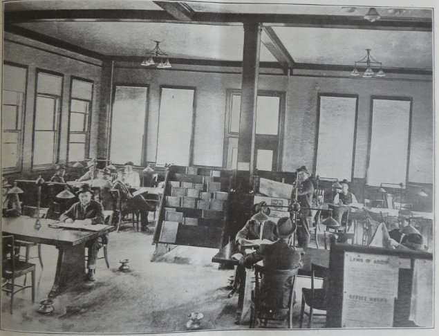 Patrons in the first floor of the Copper Queen Library circa 1910s. Photo courtesty of the Bisbee Mining and Historical Museum