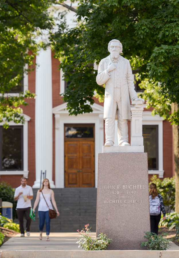 This statue honors John Buchtel and is located in front of Buchtel Hall in the center of the campus.
