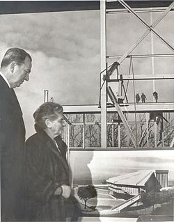 Catherine Filene Shouse and I. Lee Potter, Head of Wolf Trap Foundation, viewing plans for Filene Center, ca. 1970. (WP:NFCC#4), Fair use