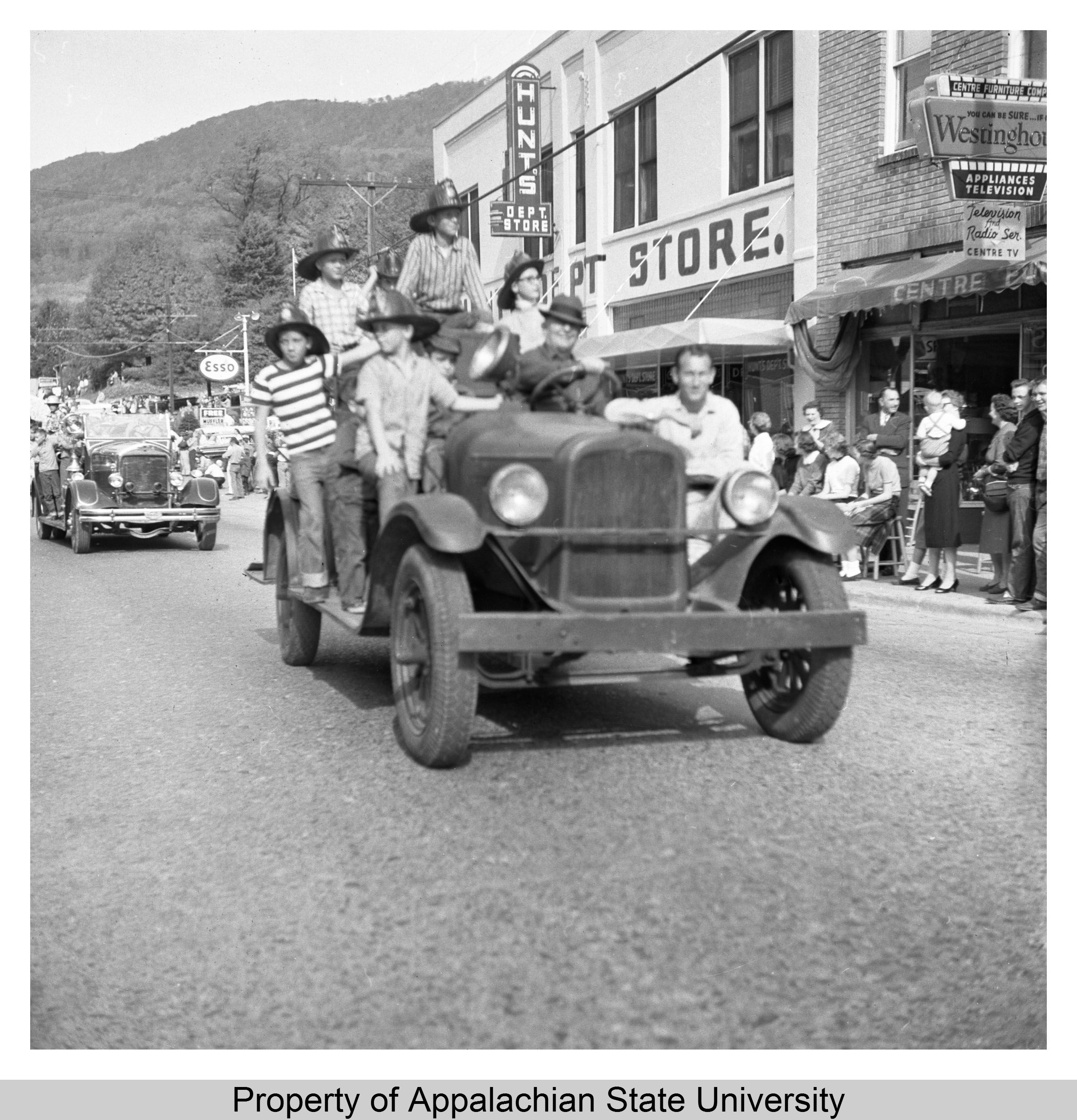 1958 Homecoming Parade, Students pass by Hunts Department Store (now Mast General Store) in downtown Boone