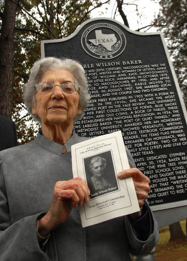 Charlotte Baker Montgomery at the site of her mother's historical marker
