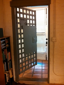 The jail's iron doors are still within and lead to eating areas, first floor and bathroom.