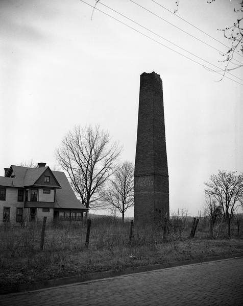 Photograph of the Buffington Mill smokestack before it was torn down