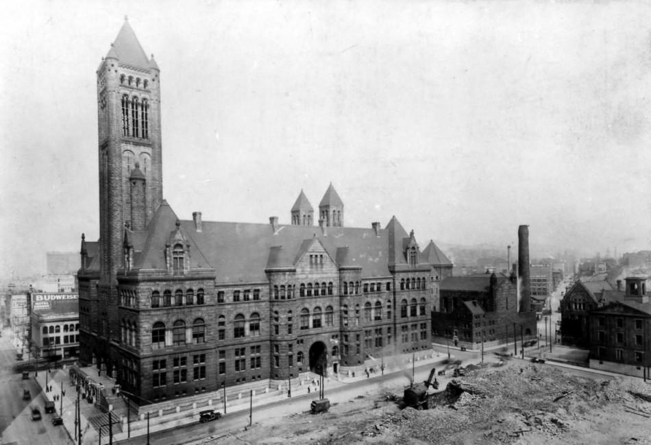 The courthouse and jail prior to being enclosed by modern skyscrapers.