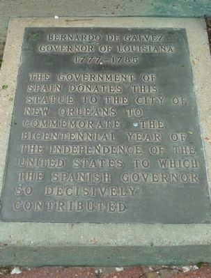 The sign at the base of the statue
