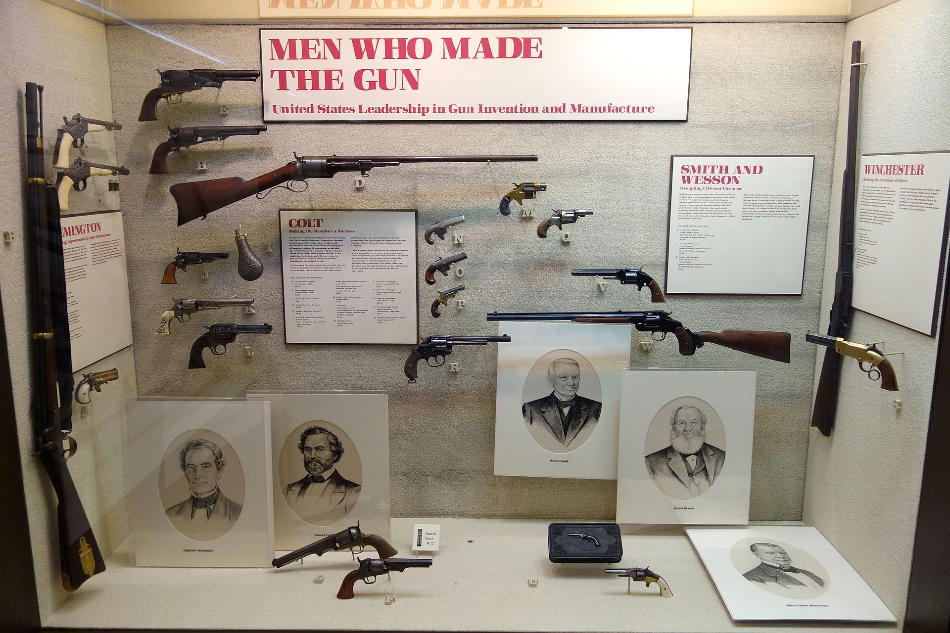 """Gun display titled """"Men Who Made the Gun: United States Leadership in Gun Invention and Manufacture"""""""