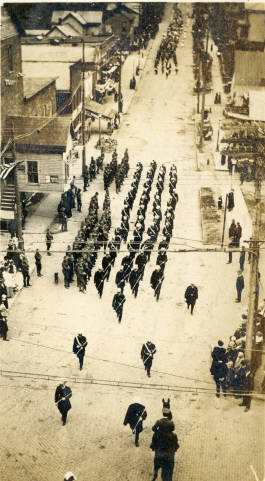 The Armory was completed and dedicated in 1917. This photograph shows troops marching along Court Street at the dedication ceremony.