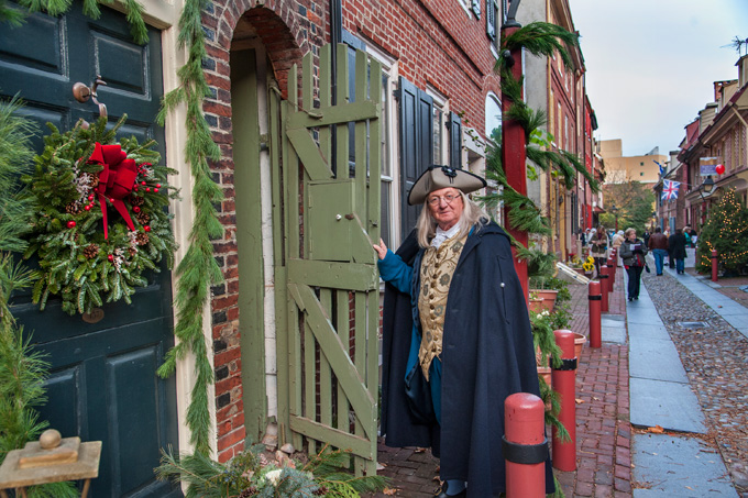 Ben Franklin pays a visit during Deck the Alley celebrations.