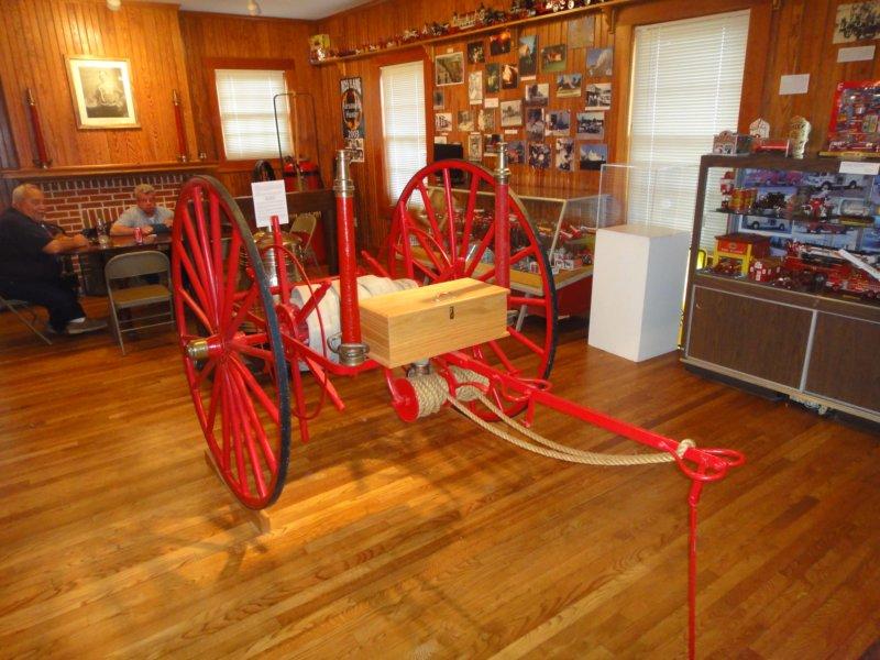 An antique fire pumper