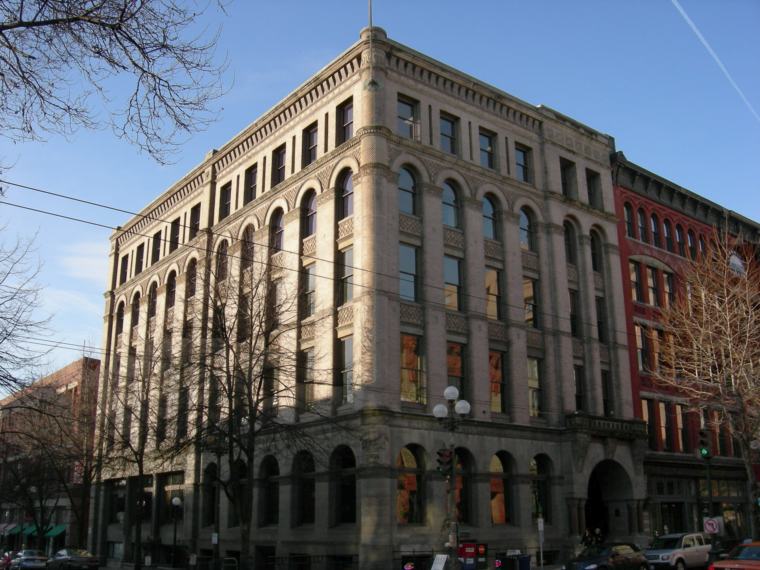 This five-story masonry building was designed by Albert Wickersham and features many elements of the Romanesque Revival style of architecture.