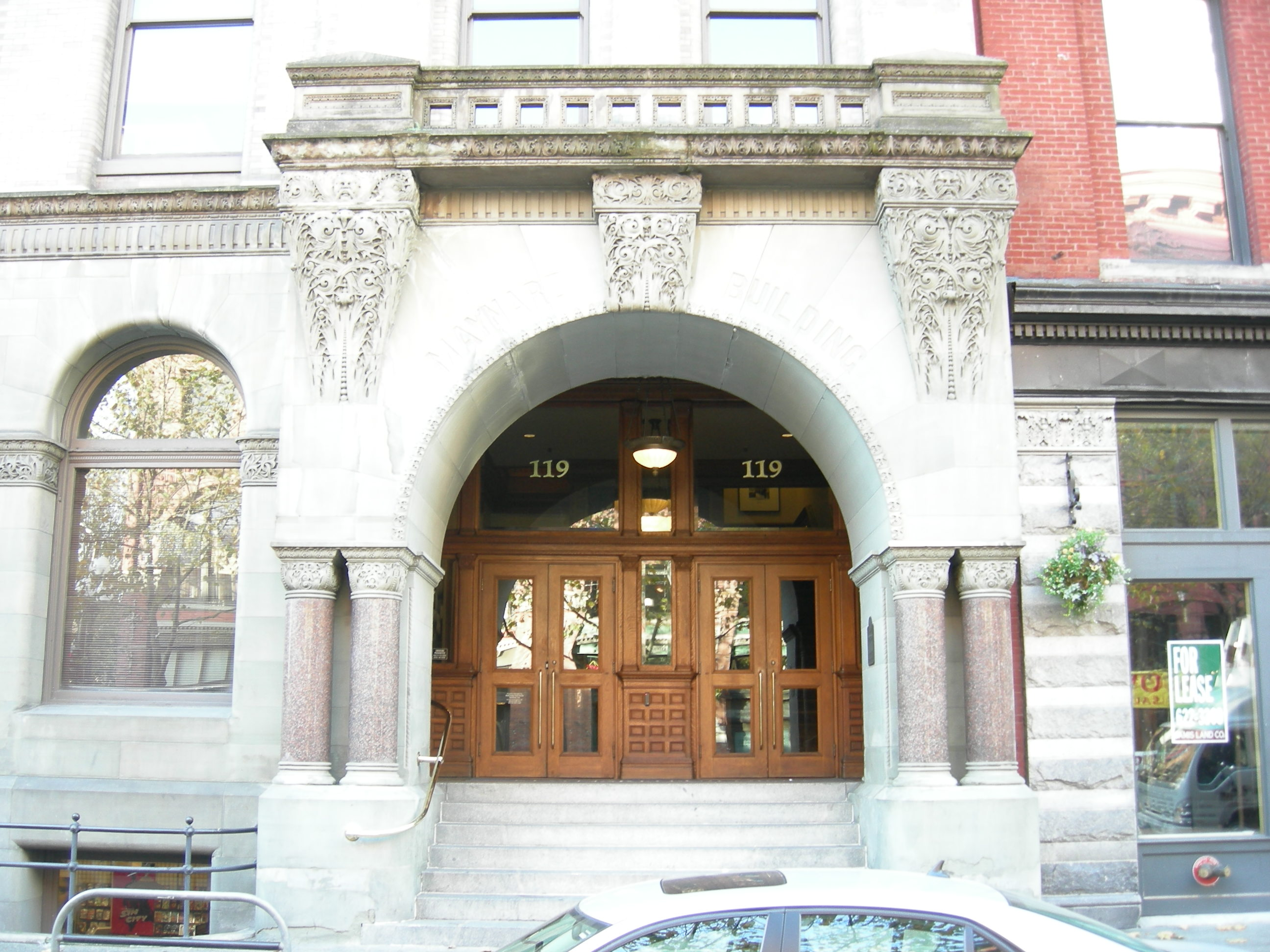 "The building's main entrance features an arch that bears the name of ""Doc"" Maynard. The building was renamed in honor of Maynard in the 1920s."
