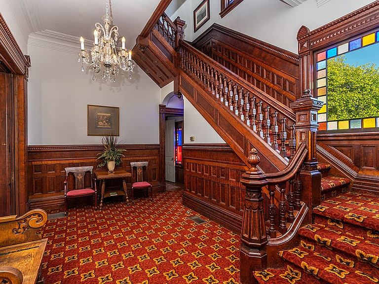 The Pink Lady staircase and stained glass window