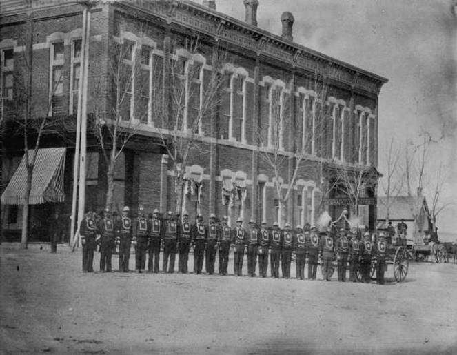 Circa 1884. The Buckingham Hose & Ladder Company stands in front of the Opera House. Courtesy of the Longmont Museum