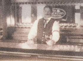 A bartender around the turn of the 20th century