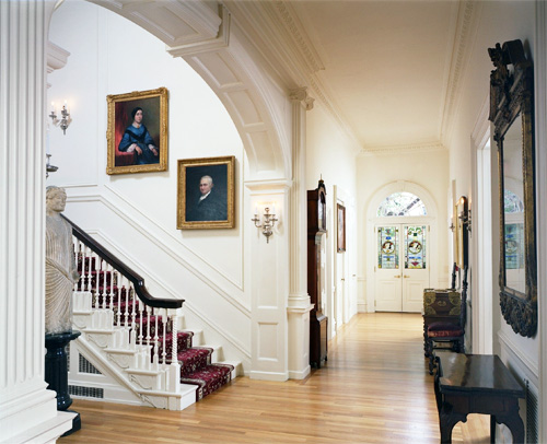 The first floor of the Rosenbach's period house museum that features portraits by Gilbert Stuart and Thomas Sully.