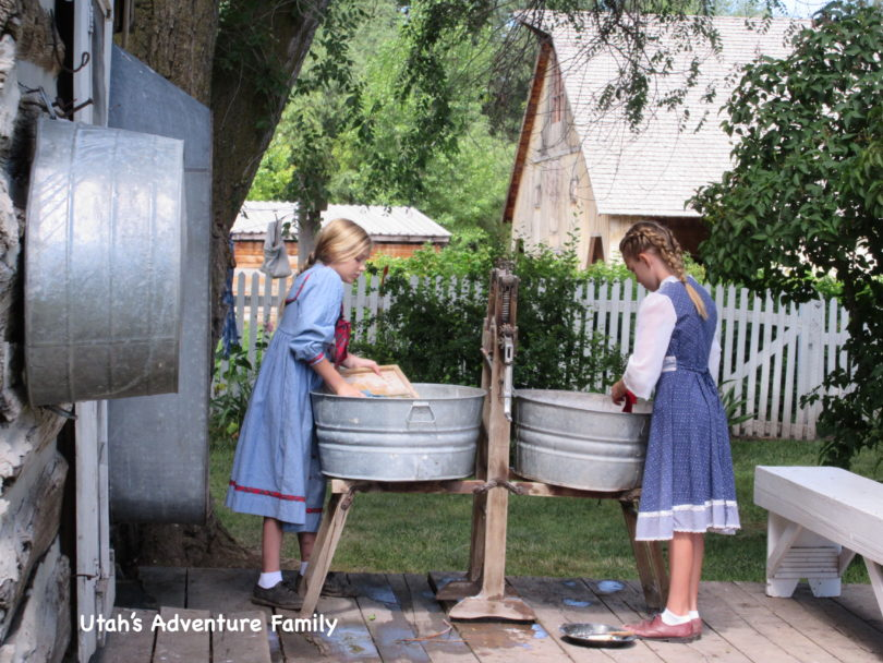 Pioneer girls washing clothes