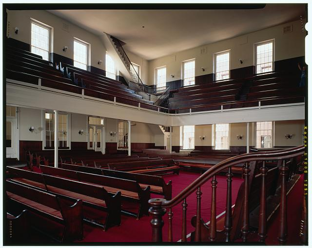 "The clean interior of the meetinghouse house to include the balcony or ""youth galleries"" that line three side of the spacious room."