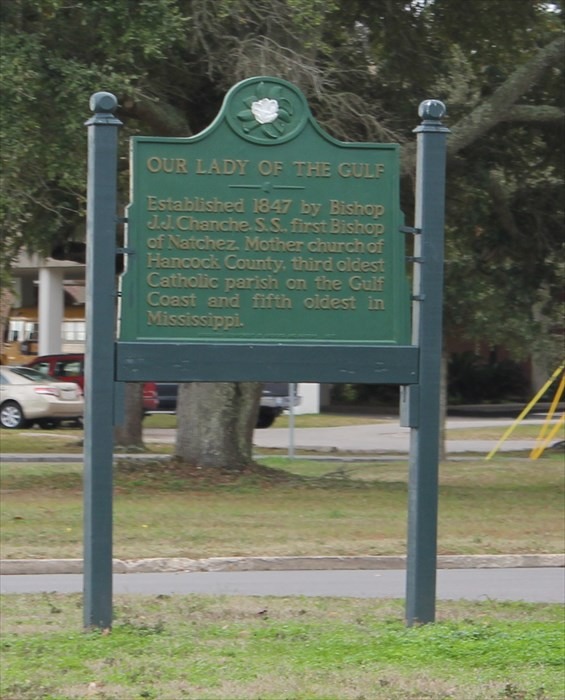 The historical marker is located next to the sidewalk in front of the church. The parish is the third oldest on the Gulf Coast.