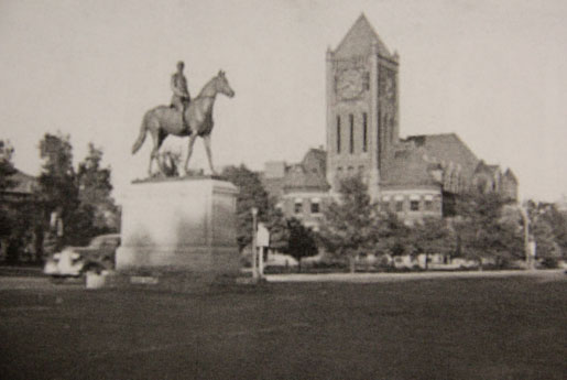 Circa 1930s. The General William Palmer statue sits in front of the original high school.