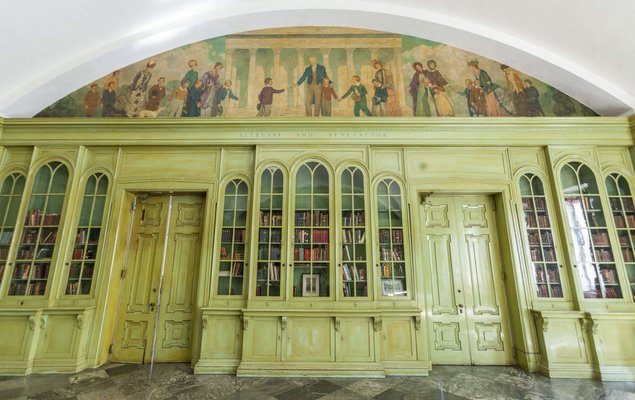 One of the large interior rooms of Founder's with a mural of Girard painted above the doors.