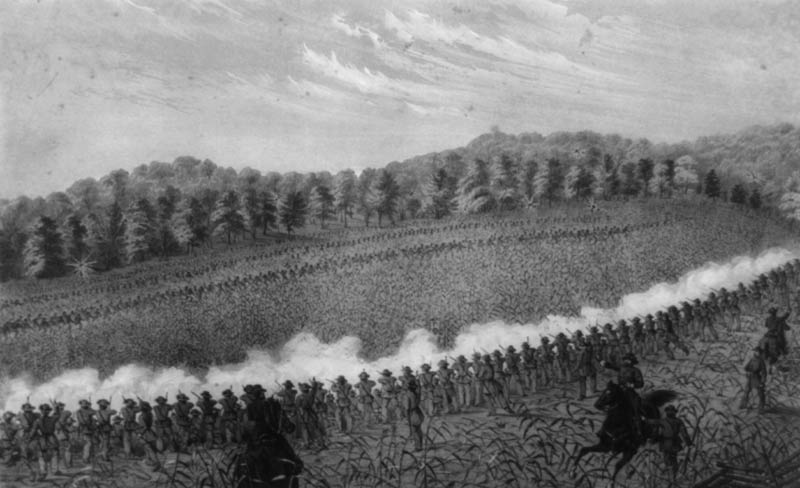 A black and white photograph showing the Union and Confederate forces battling it out.