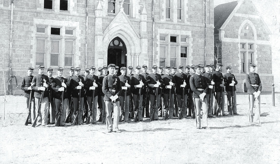 Cutler Hall Drill Academy standing in front of Cutler Hall in 1892