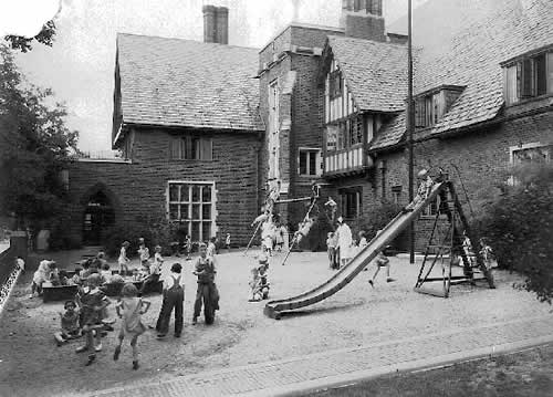 Circa 1930s. Children at play in Nursery's playground