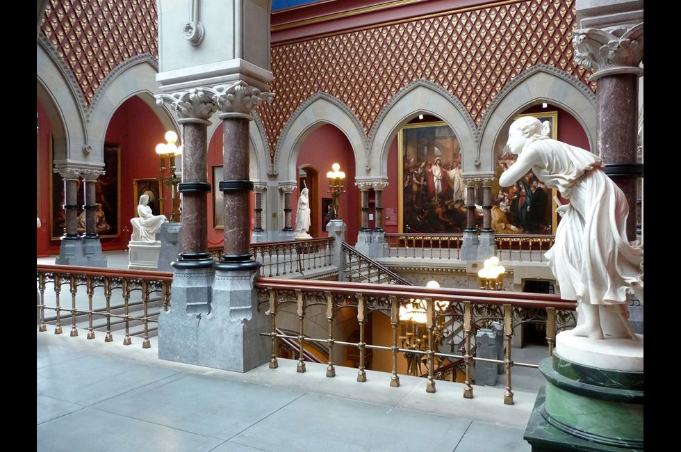 The academy's ornate central staircase that leads up to exhibit space on the second floor.  As one ascends, it's difficult to keep ones' eyes off the works of art and on the stairs.