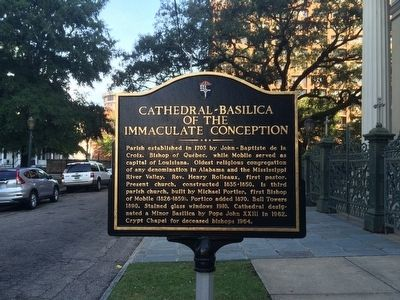 The historical marker is located in front of the cathedral