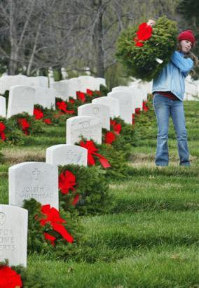 Laying wreaths at soldier tombstones
