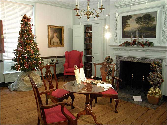 The parlor at Woodford boasts antique furniture and a beautiful fireplace overmantel.