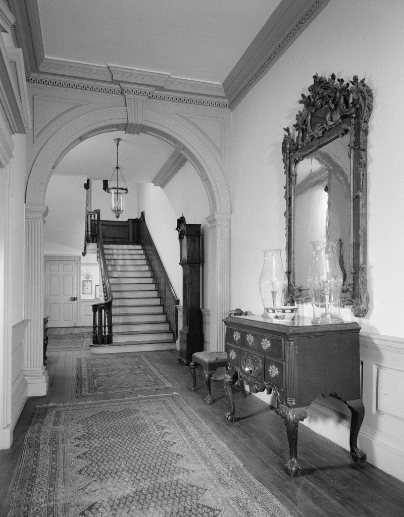 The Powel House's restored front entryway and mahogany staircase.