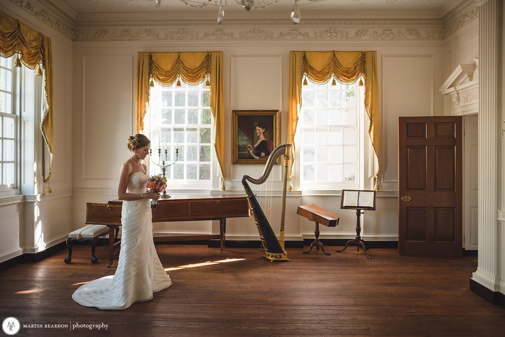 A bride contemplates her upcoming nuptials in the Powel House's front parlor.