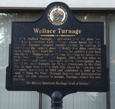 The marker is located on the sidewalk next to the Saenger Theatre Mobile.