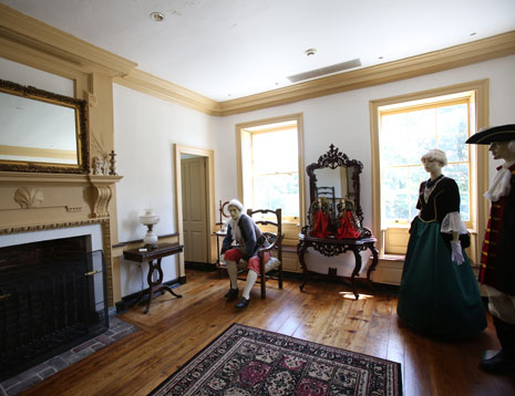 Mannequins, attired in period dress, stand silent in Belmont's front parlor.
