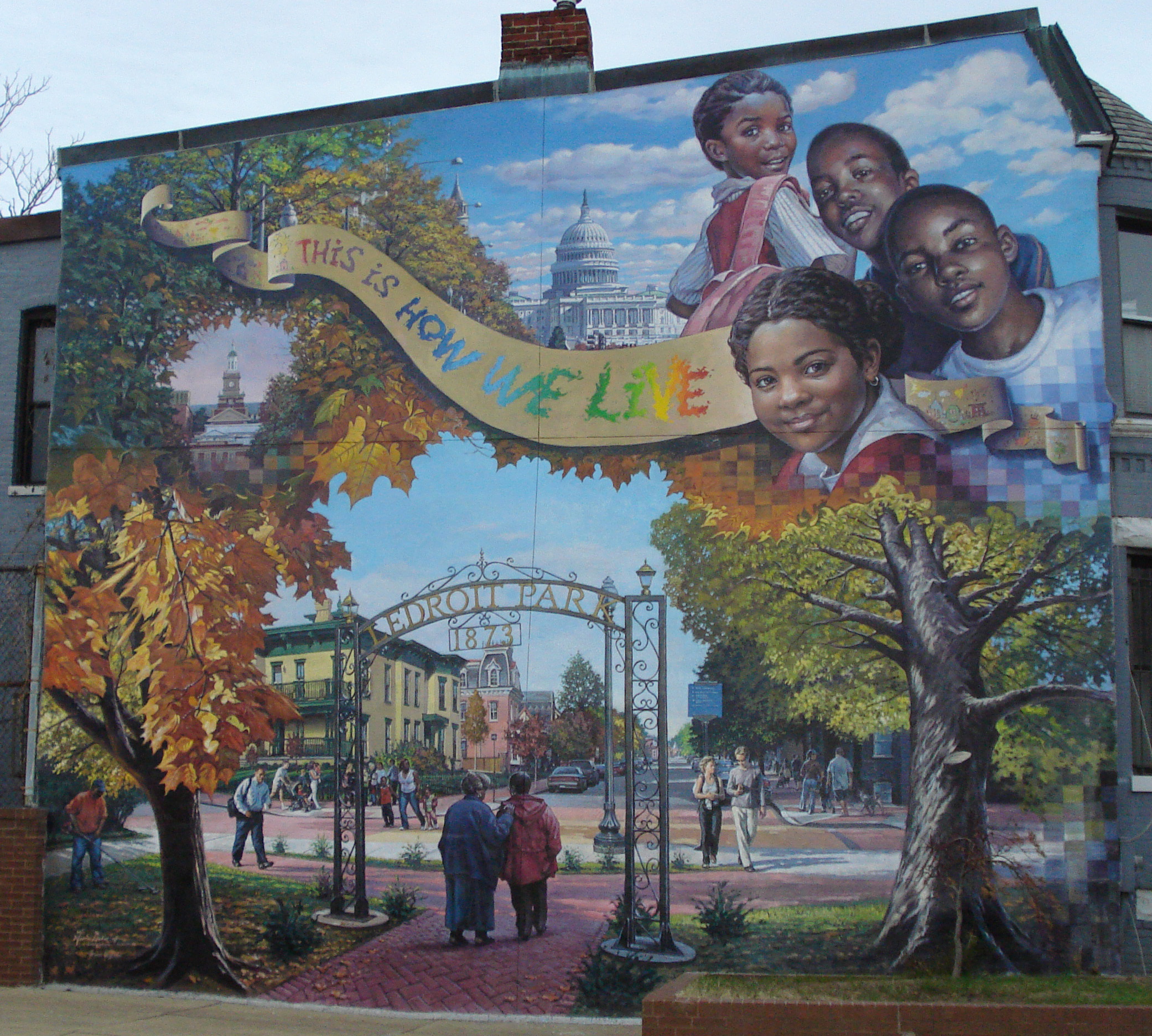 """This is How We Live,"" a mural from The Park at LeDroit by Garin Baker. CC BY-SA 3.0, https://en.wikipedia.org/w/index.php?curid=20967083"