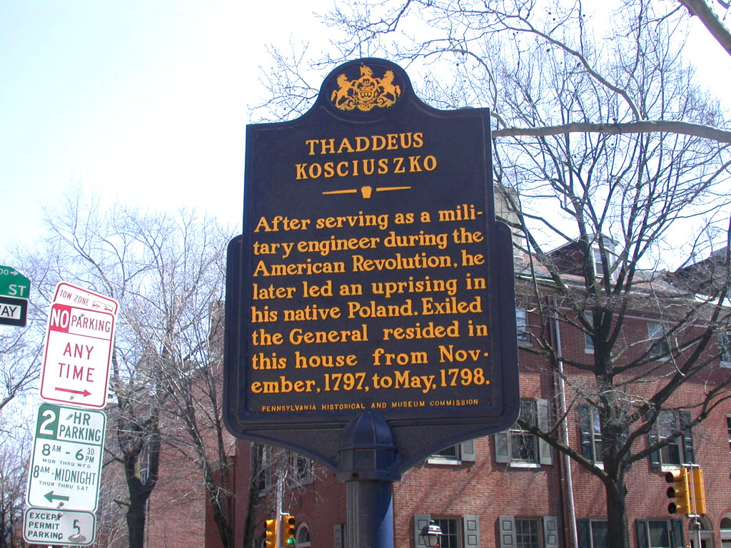 The historical marker located across the street from the memorial.