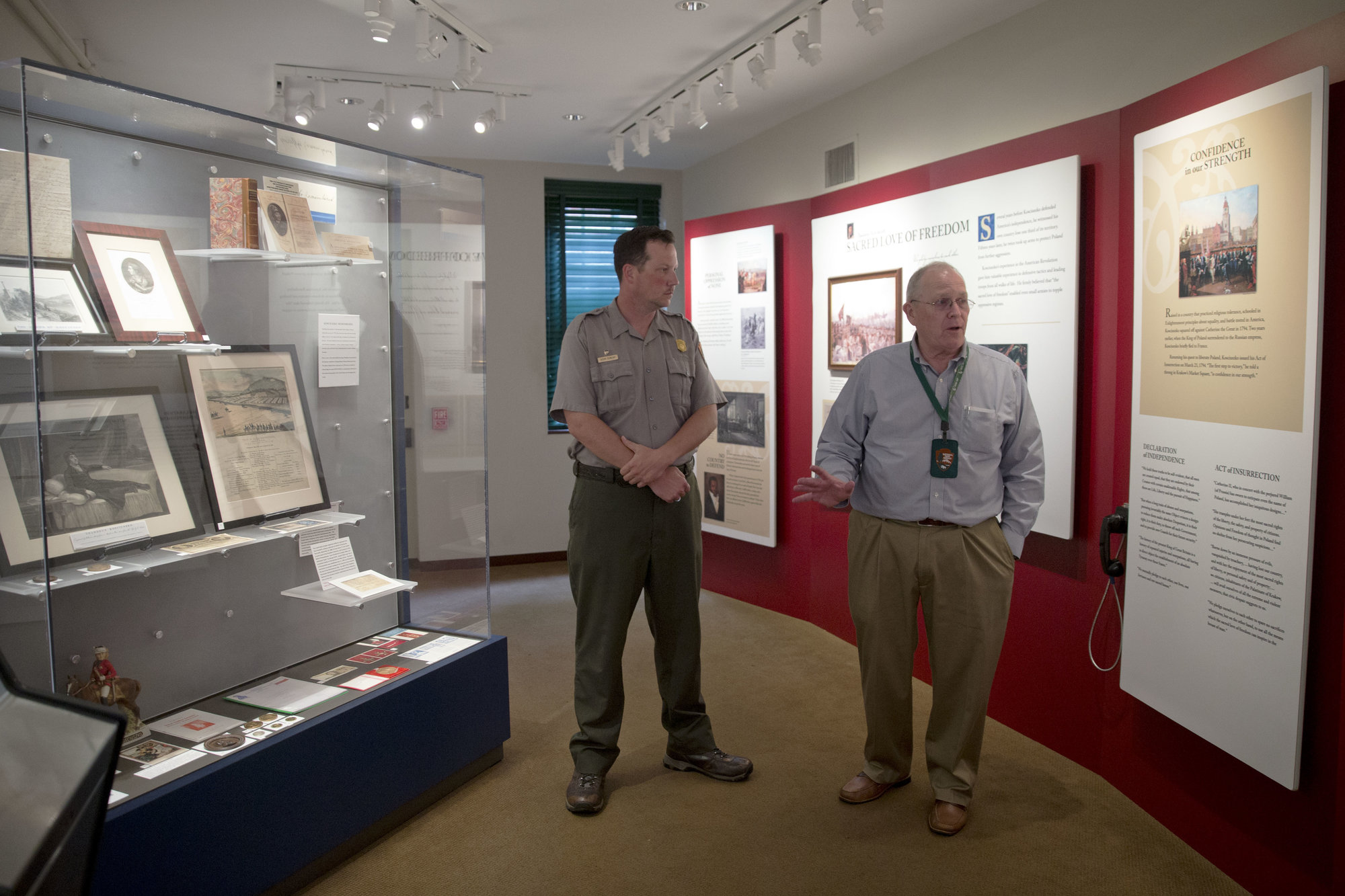 A park ranger discusses Kosciuszko's life with a visitor among the first floor interpretive exhibits.