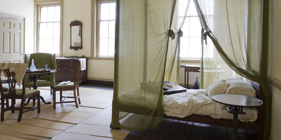 The Bishop's bedroom with the last book read by Dr. White still on his lap desk.  Notice the mosquito netting, a lasting reminder of the yellow fever epidemics that ravaged the city during his lifetime.