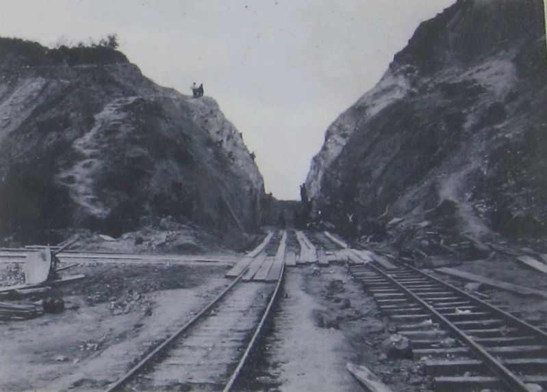 Converting the old Steam Train Line into the new Electric Streetcar Line by widening the path and replacing the tracks, c. 1905