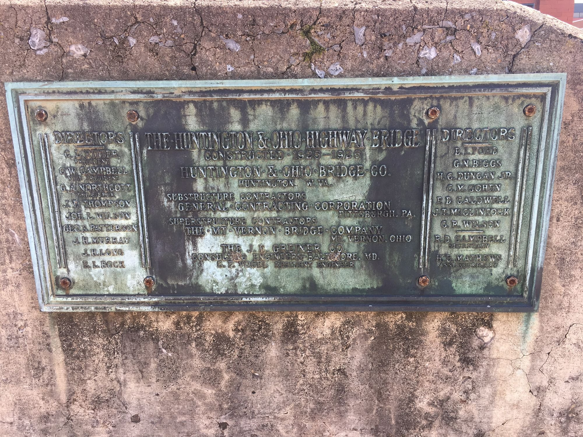 A surviving slab of concrete with the original bridge's dedication plaque is on display at Huntington's Heritage Station. Image courtesy of Steven Cody Straley.