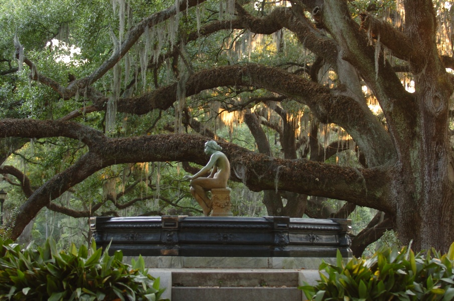 A sculpture of a water nymph, Chloe, sits among City Park's live oaks, some of which are well over 600 years old.