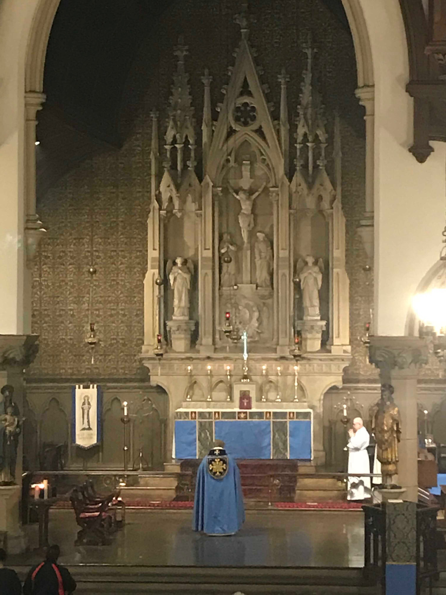The chancel and carved stone reredos in Advent season.