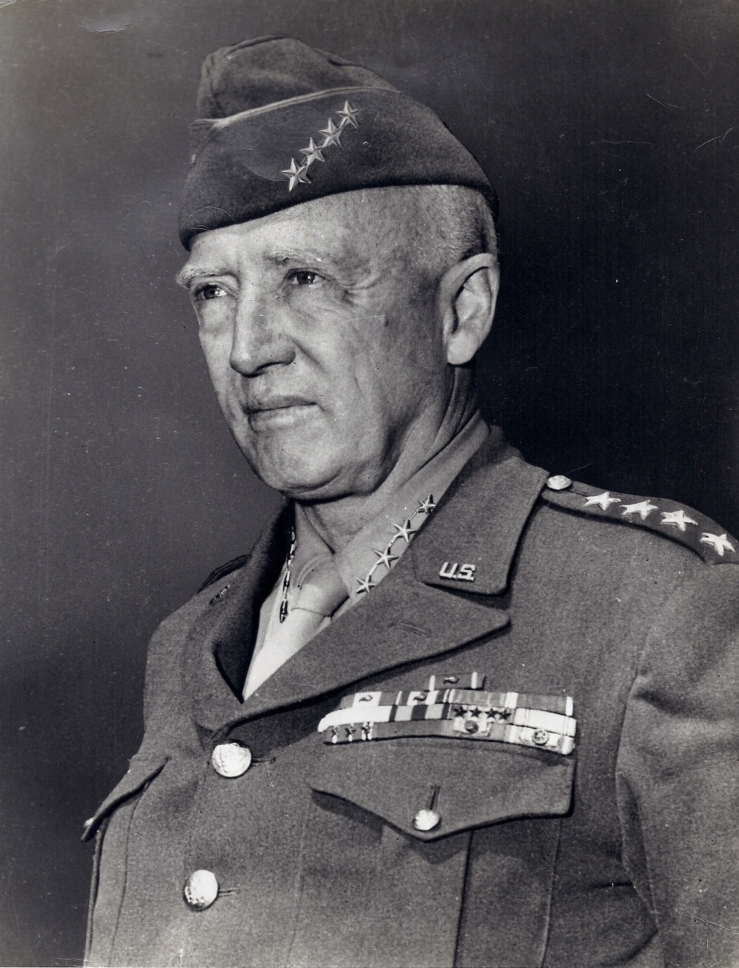 Photograph of General George Smith Patton, Junior in full military uniform and vice-cap bearing his four stars