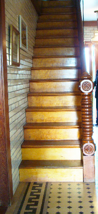 This narrow staircase leads to the home's second floor.  Guests would use the double-staircase on the home's exterior to access the second floor.