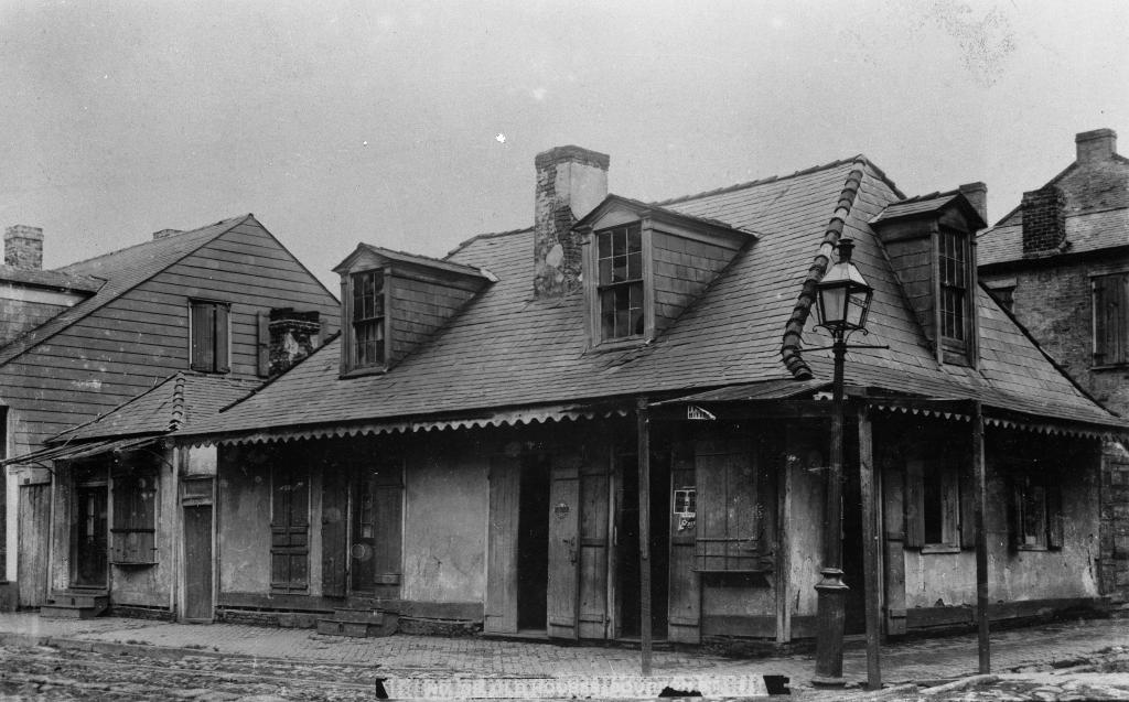 This c. 1900 photograph of Lafitte's shows the small outbuilding, on the left, that once existed where the courtyard was later built.
