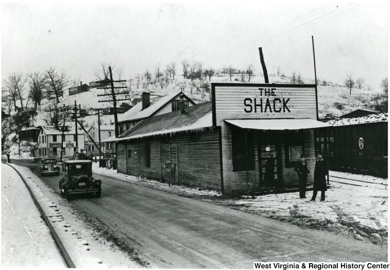 Two men in front of The Shack